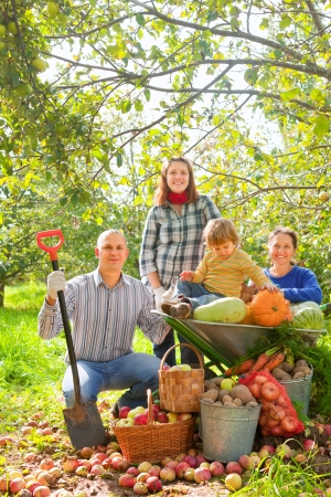 Happy  family with  harvest in vegetable garden photo