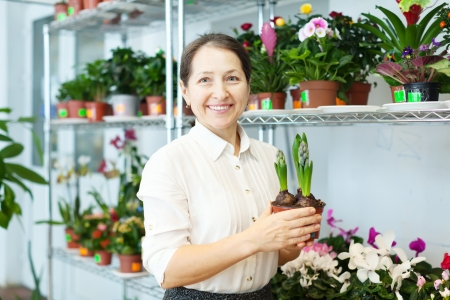 Happy  woman with hyacinth (Hyacinthus) in flower store Stock Photo - 18655001