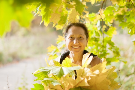 Outdoor portrait of mature woman in autumn Stock Photo - 18655009
