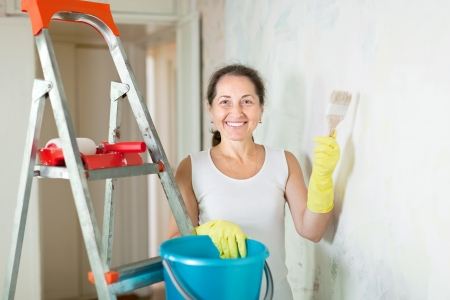 Mature woman makes repairs in the apartment Stock Photo - 18654986