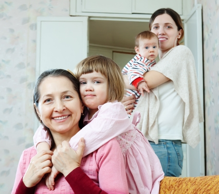 Happy mature woman and adult daughter with two children Stock Photo - 18714721