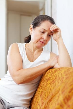 depressed woman: sadness mature woman at  home