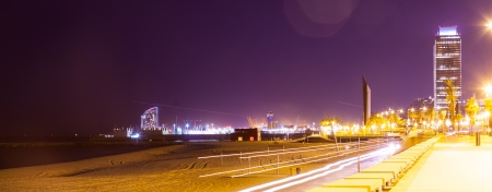 night view of Port Olimpic - center of nightlife at Barcelona, Spain  photo