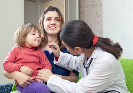 mature  doctor examining 2 years child at home Stock Photo - 18786333