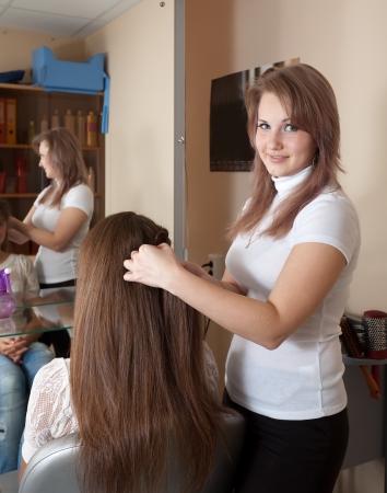 Female hairdresser works on woman hair in salon Stock Photo - 18872416