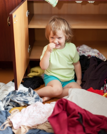 Baby girl  chooses dress in parents closet