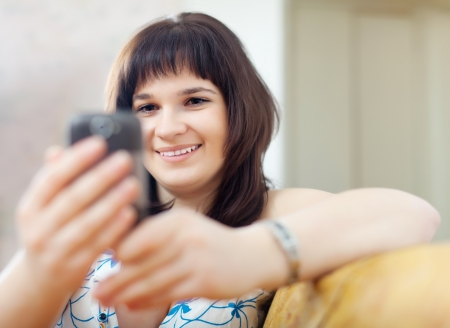 ordinary  woman using electronic device at home photo