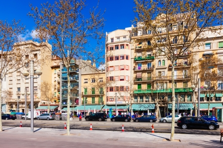olden day: BARCELONA, SPAIN - MARCH 28: La Barceloneta district in March 28, 2013 in Barcelona, Spain. It is neighborhood in the Ciutat Vella district between Port Vell and Port Olimpic