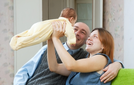 Happy parents with newborn baby in home  Stock Photo - 19000863