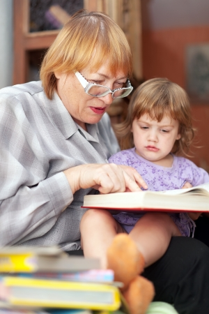 grandmother and child reads  book. Focus on woman Stock Photo - 19115171