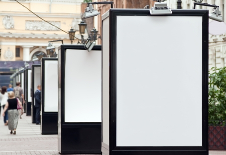 advertisers: many blank billboard for advertisers to place ad copy samples on city street Stock Photo