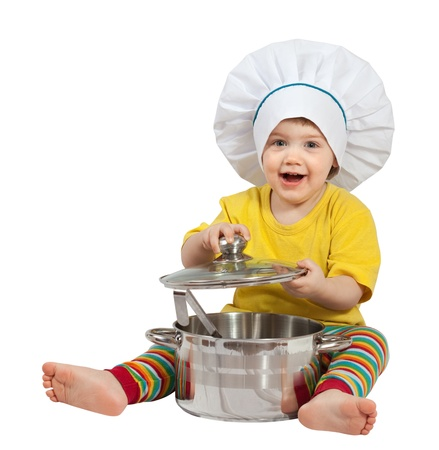 toque: Baby cook in toque with  pan. Isolated over white background Stock Photo