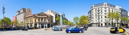 BARCELONA, SPAIN - APRIL 14: Panorama of Crossing Gran Via and Passeig de Gracia in April 14, 2013 in Barcelona, Spain. It one of major avenue in city