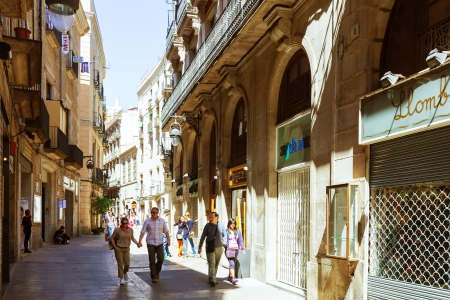 BARCELONA, SPAIN- APRIL 14: Pedestrian streets of Gothic Quarter in April 14, 2013 in Barcelona, Spain. It is centre of old city, name of quarter was due to the preserved buildings, erected in Medieval time