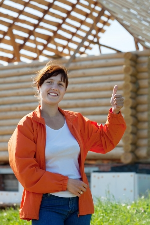 Happy  young woman  in front of building new home Stock Photo - 19379057