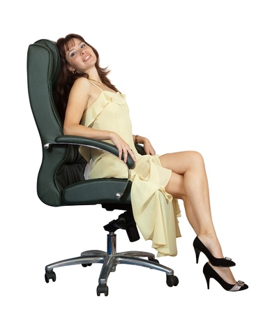 Sexy woman sitting on luxury office armchair, isolated over white background photo