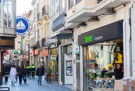 3rd century: BADALONA, SPAIN - FEBRUARY 26: Shopping street of Badalona in February 26, 2013 in Badalona, Spain., City was founded by the Romans in the 3rd century BC., Population: 220, 977 (2012 Census) Editorial
