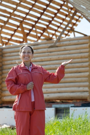 Happy  mature woman  in front of building new home Stock Photo - 19426187