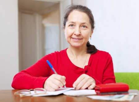 woman is calculated the family budget at  home Stock Photo - 19426132