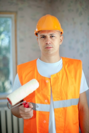 unskilled worker: house painters with paint roller is ready for operation
