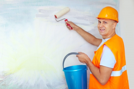 house painters with paint roller is ready for operation