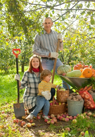 Happy  family with vegetables harvest in garden Stock Photo - 19528614