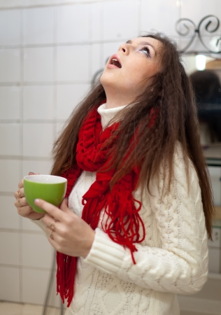tonsillitis: Colds woman gargling throat in her bathroom at home
