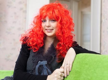 peruke: Woman in red peruke at home