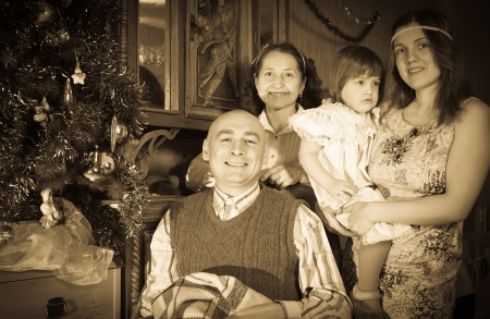 Retro photo of happy  family of three generations posing for  Christmas portrait at home Stock Photo - 19611842