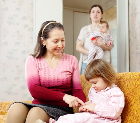Two women with children plays at home Stock Photo - 19590955