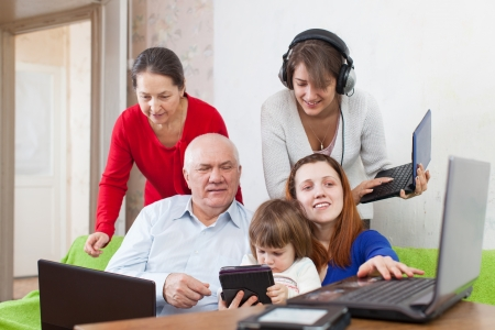 people  uses few various electronic devices in home interior