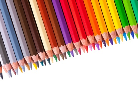 Many pencils with copyspase over white photo