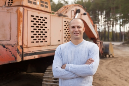 Portrait of tractor operator at workplace photo