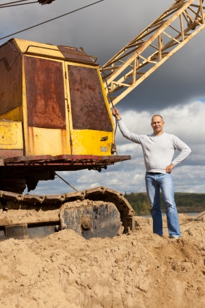 spalpeen: Portrait of tractor operator at sand pit