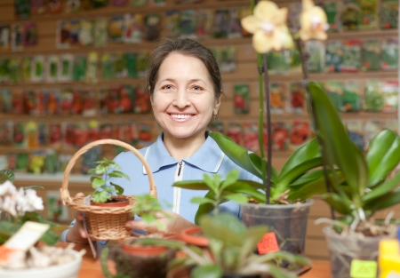 Smiling mature woman in store for gardeners photo
