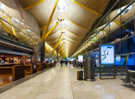 barajas: MADRID, SPAIN - APRIL 26: Barajas Airport in April 26, 2013 in Madrid, Spain. Interior of Terminal 4, designed by Antonio Lamela and Richard Rogers