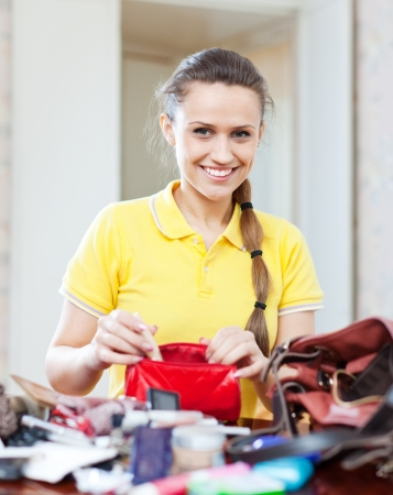 ransack:  beautiful inconsiderate woman lost something and found this thing in purse at home