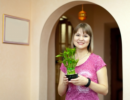 Girl with lucky bamboo at her home photo