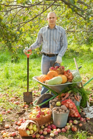 man with vegetables harvest in garden photo
