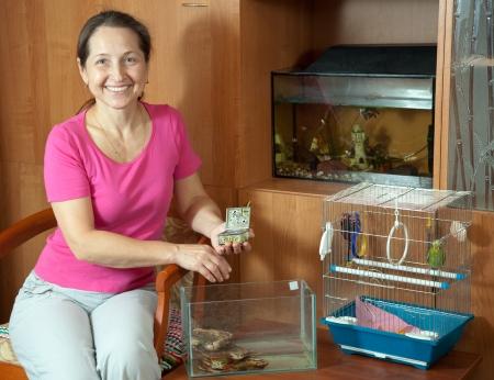 aquaria: Woman feeding domestic animals in the house