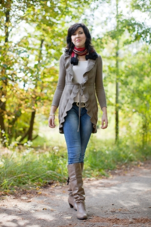 Full length shot of girl  in autumn park  photo