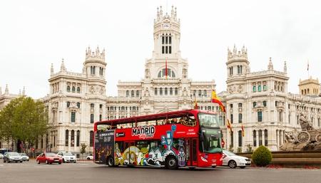 palacio de comunicaciones: MADRID, SPAIN - APRIL 26: Touristic bus against Palace of Communication in April 26, 2013 in Madrid, Spain.Palace of Communication, since 2011 named Cibeles Palace (Palacio de Cibeles) Editorial