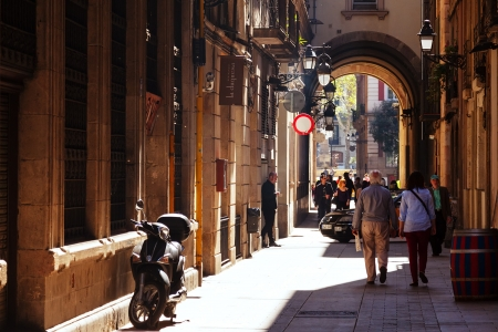 BARCELONA, CATALONIA - APRIL 14: Old streets of Barrio Gotico in April 14, 2013 in Barcelona, Catalonia. It is centre of old city of Barcelona. Center of touristic life
