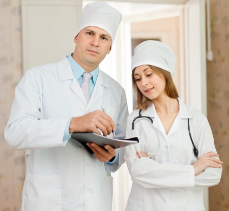 Portrait of doctor and nurse in hospital interior photo
