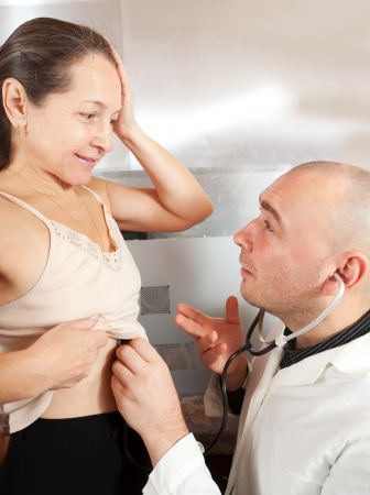 auscultoscope: Doctor listening  the patient with  stethoscope in clinic