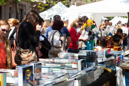 BARCELONA, SPAIN - APRIL 23: Books on street stalls in April 23, 2013 in Barcelona, Spain. Saint George is saint patron of city, ​​decided to give red roses and books
