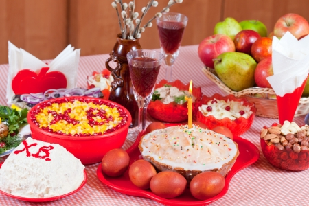 holiday meal: celebrate table with Easter cake  and holiday meal
