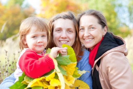 20 23 years: Portrait of three generations women in the autumn park