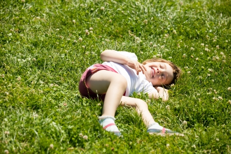 happy three year old  child in green grass meadow photo