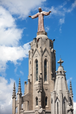 BARCELONA, SPAIN - MAY 18: Jesus on Temple Expiatori del Sagrat Cor in May 18, 2013 in Barcelona, Spain. The construction of the temple dedicated to Sacred Heart, lasted from 1902 to 1961 Stock Photo - 20187870
